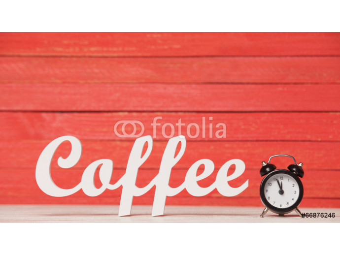 Alarm clock and wooden word Coffee. 64238
