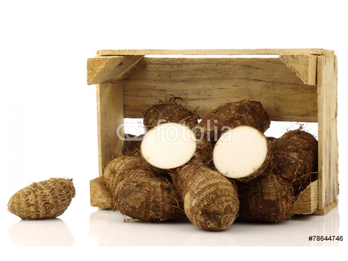 taro root(colocasia) in a wooden crate on a white background 64238