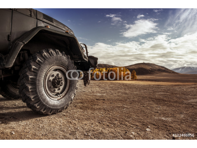 Truck car wheel on offroad steppe adventure trail 64238