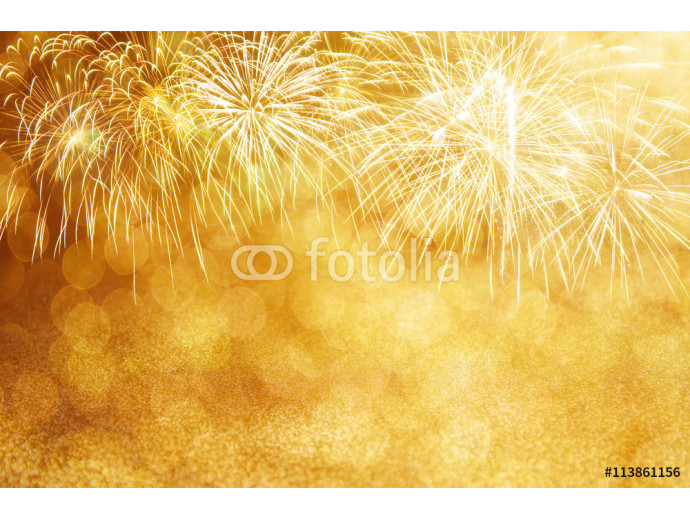 Defocused Gold fireworks and bokeh at New Year and copy space. Abstract background holiday. 64238