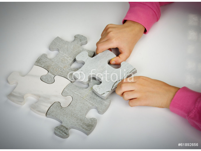 Kids connecting the jigsaw puzzle 64238