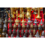 row of shiny traditional coffee pots and lamp 64238