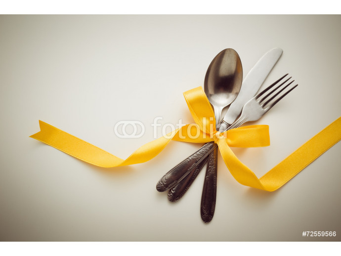 Fork, spoon and knife with decorative ribbon. 64238