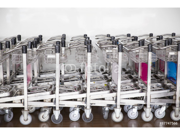 trolleys luggage in a row in airport 64238