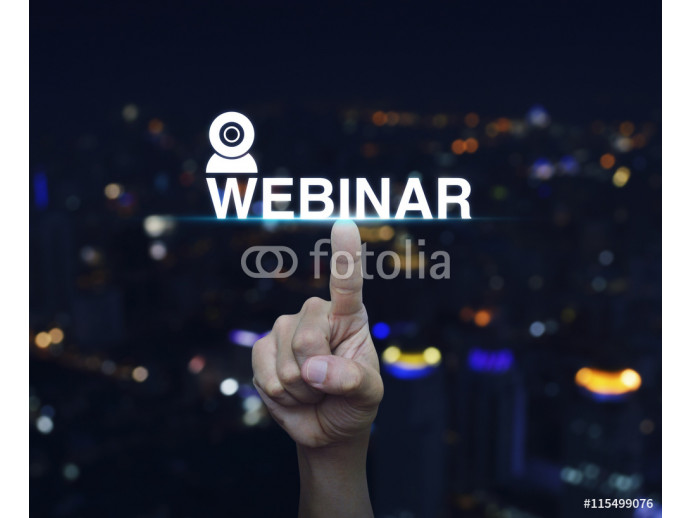 Hand pressing webinar button over blur night city tower backgrou 64238