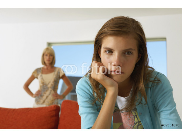Girl upset, mother in the background. 64238