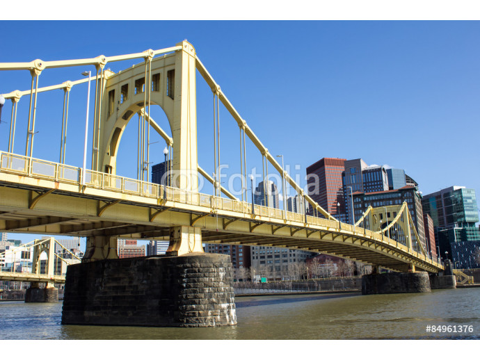 Yellow Bridge On Stone Supports - Side Views of a Yellow Painted Iron Suspension Bridge Across the Allegheny River Toward Downtown Pittsburgh Pennsylvania 64238