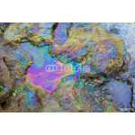 rainbow reflection of crude oil spill on the stone at the beach 64238