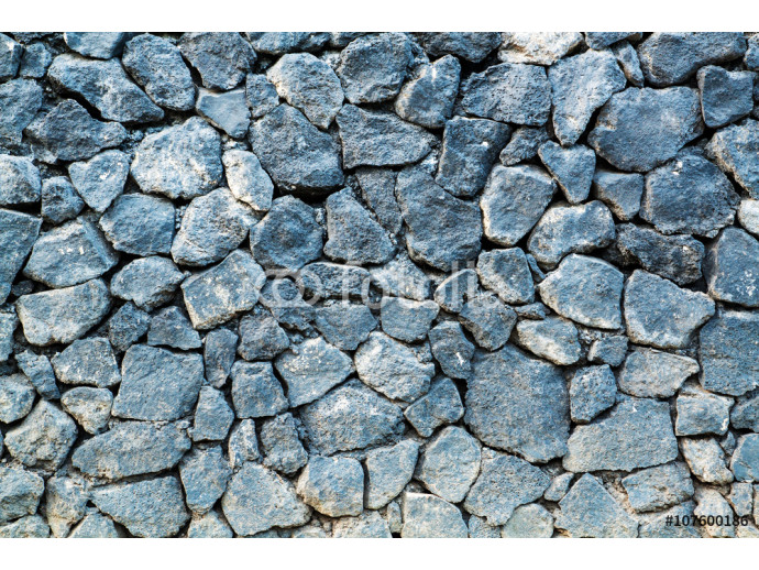 volcanic pumice rock wall background. 64238