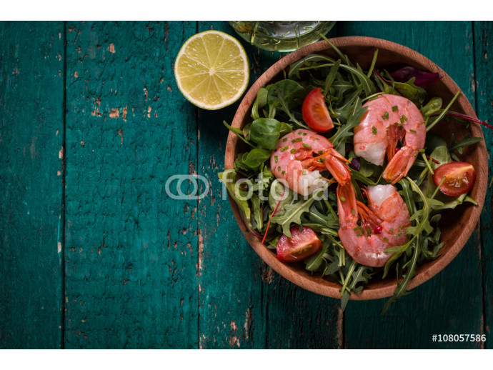 Green salad with shrimps on wooden table.healthy food 64238