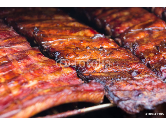 Spare ribs on grill - smoked pork ribs 64238