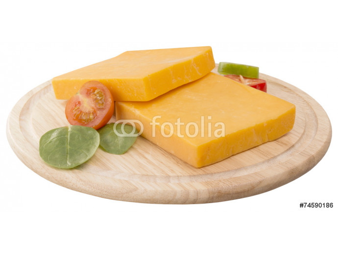 two slices of cheddar on wooden board decorated with cherry and 64238