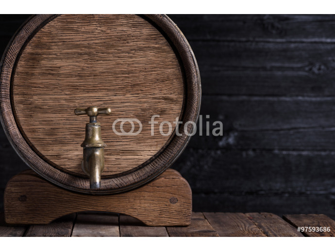 Old oak barrel on wooden table still life with copy space 64238