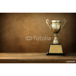 champion golden trophy on wood table with blackboard copy space 64238