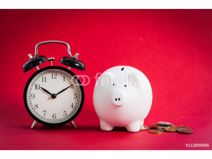 Piggy bank on red background 64238