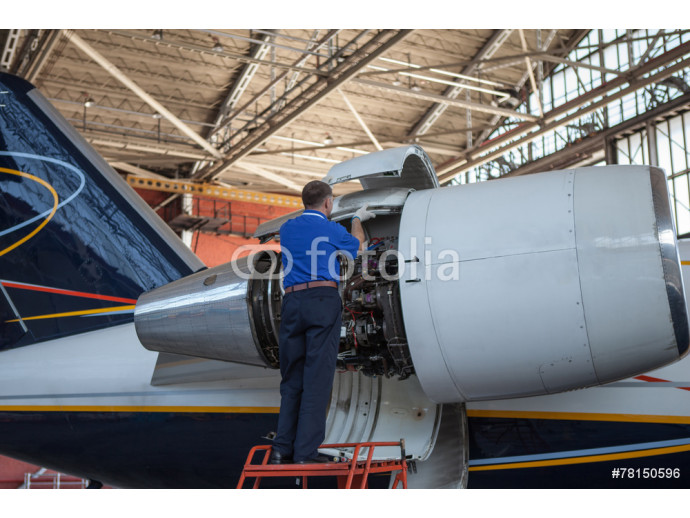 Business jet airplane stays in hangar.. 64238