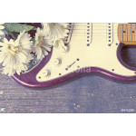 electric guitar with flower on wooden background 64238