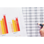 Sales Managers Working Modern Studio.Woman Showing Hand Market Report Charts.Marketing Department Planning New Strategy.Researching Process Wood Table.Horizontal.Blurred Background.Film effect. 64238