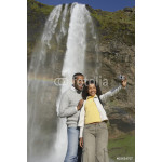 Couple taking own photograph with waterfall 64238