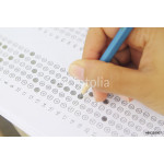 Standardized test form with answers bubbled in and a pencil, foc 64238