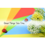 "Motivation quote ""GREAT THINGS TAKE TIME"" over colorful colored paper with artificial flower and decoration. Selective focus applied. 64238"