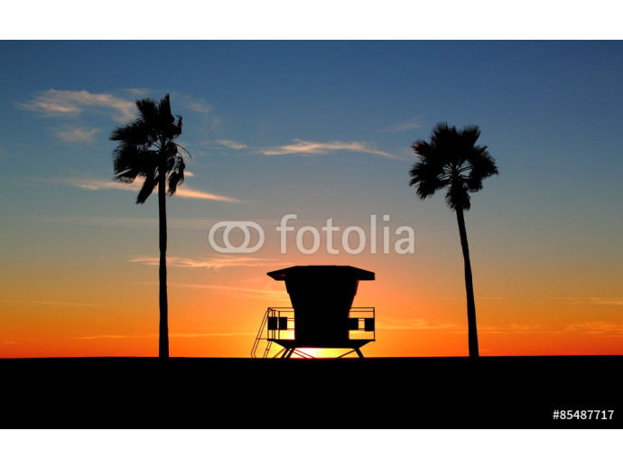 Photo wallpaper Silhouette of a California life guard station at sunset with Palm Trees 64238