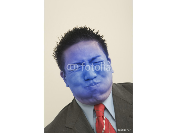 Young businessman holding breath and turning blue 64238