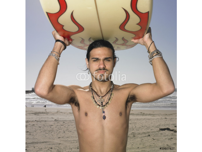 Man with surf board on head at beach 64238
