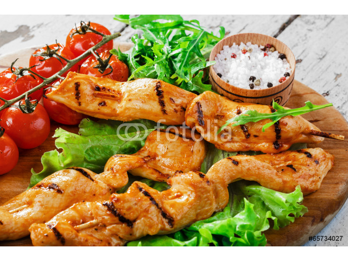 Grilled chicken on wooden skewers 64238