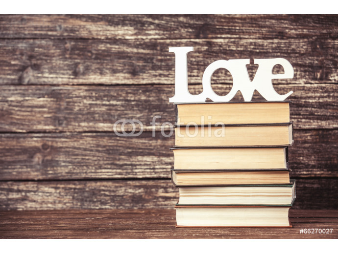 Word love and books on wooden table. 64238