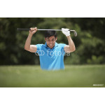 Frustrated Hispanic man holding golf club 64238