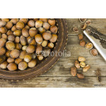 Hazelnut in a wooden bowl on rustic background 64238