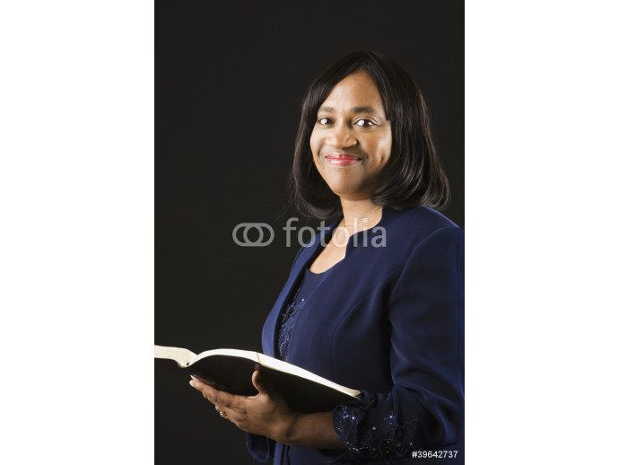 African woman holding open bible 64238