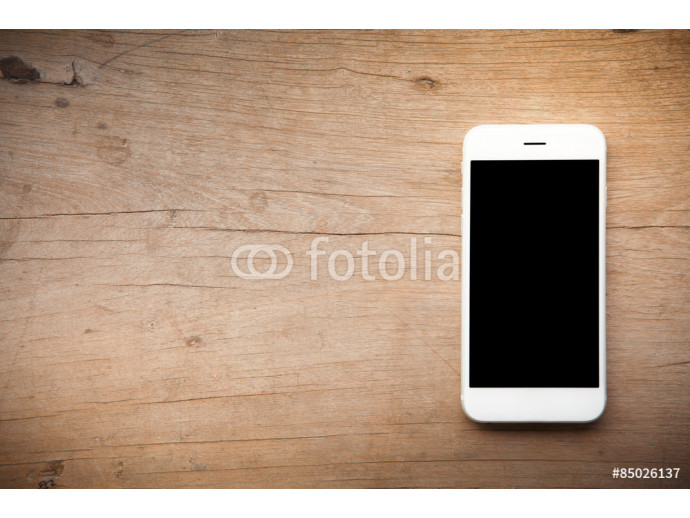 Smart phone on wooden background 64238
