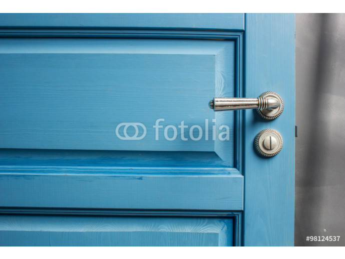 Fototapeta open wooden door painted in blue with a beautiful a metal handle and the castle 64238