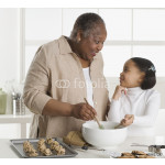 Senior woman making cookies with her granddaughter 64238