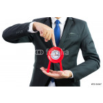Red clock holding in businessman hands isolated 64238