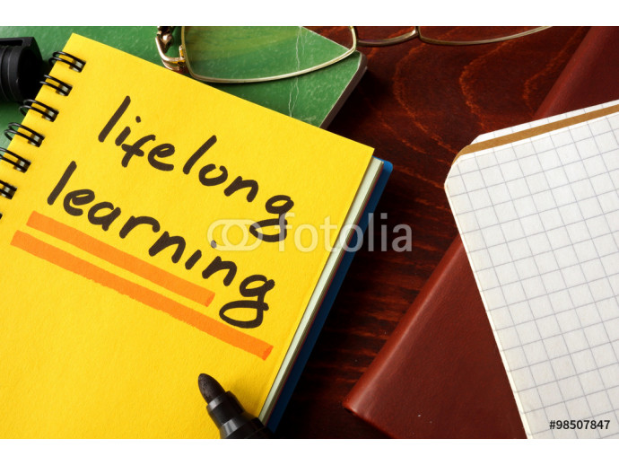 Notebook with  lifelong learning sign. Education concept. 64238