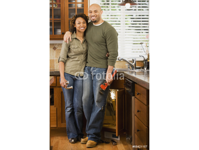 African couple installing kitchen sink 64238