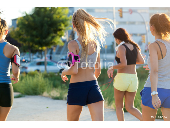 Group of women running in the park. 64238