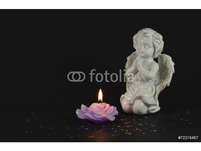 Ornamental angels with candle isolated on black for Christmas 64238