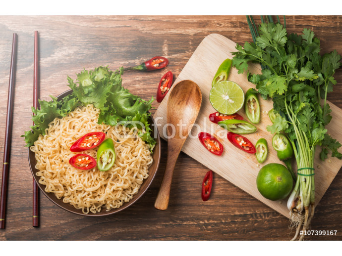 Instant noodles in bowl and vegetable 64238