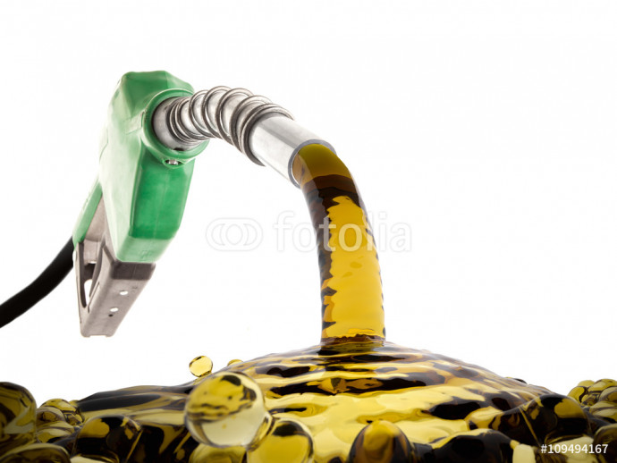 Green gas nozzle wasting fuel on white background 64238