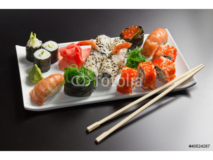 Japanese  seafood  sushi , roll and chopstick on a white plate 64238