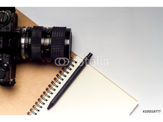 diary with camera and pencil on white vintage background 64238