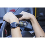 Woman's hands on the steering wheel of the car. 64238