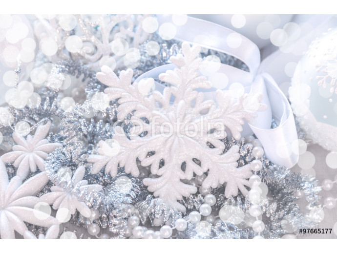 Unfocused silver and white snowflake glitter bokeh holiday background. Winter xmas holidays. Christmas.. 64238