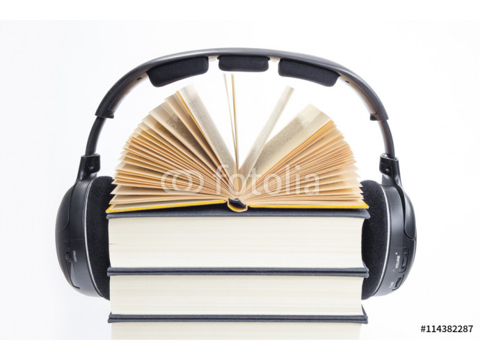 Group of books and headphones related to audio books on isolated background 64238