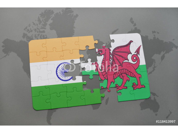 Vliestapete puzzle with the national flag of india and wales on a world map background. 64238