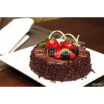 Chocolate cake with fresh fruit decoration. 64238